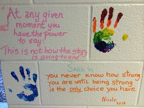 a wall with the painted hands of the Scavone girls